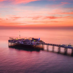 Birdseye view of Brighton Palace Pier during sunset.